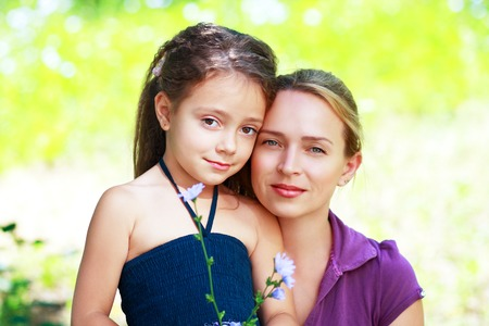 30 35 years: Smiling mother and little daughter on nature. Happy people outdoors