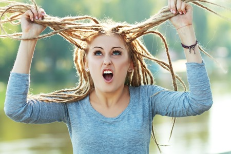 Young beautiful woman with dreadlocks photo