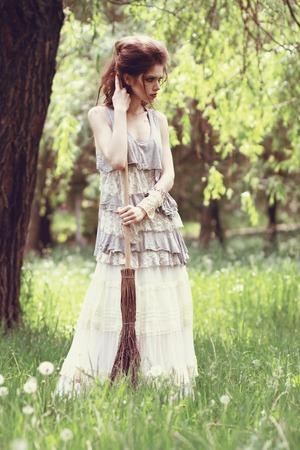 ourdoor: Boho fashion style Sindirella sweeping ourdoor Stock Photo