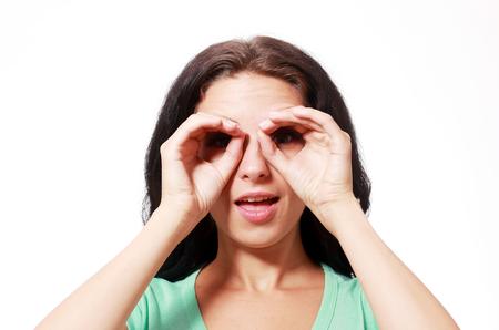 represents: smiling girl with hands represents imagine binoculars