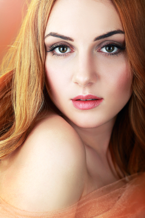 Close-up portrait of an attractive red-haired girl Stock Photo