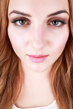 Portrait of a young woman with beautiful hair and brown eyes Selfie concept big eyes