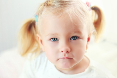 Close up portrait of adorable 2 years old girl