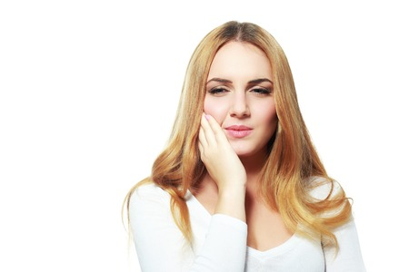 cheek: Woman with toothache hold her cheek Stock Photo