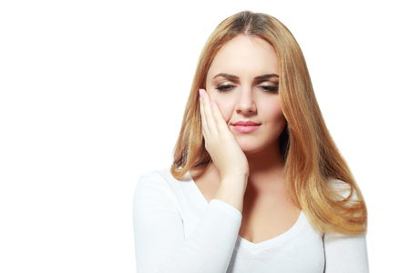 painfully: Woman with toothache , isolated on white