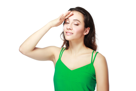 memory loss: Close-up portrait of young stressed woman touching her forehead in pain. Memory loss and headache concept.