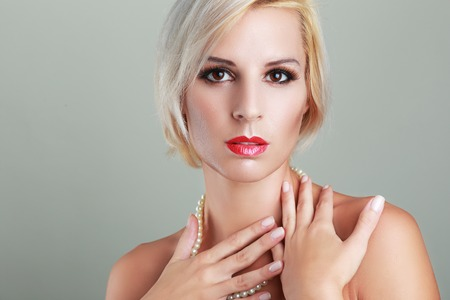 short haircut: beautiful blond woman with short haircut with perfect skin fashion toned image