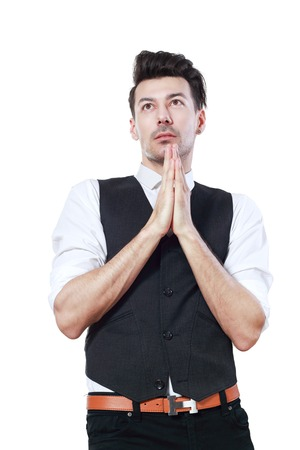 bowing head: A young man prays over white background looking up