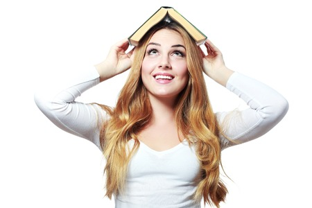 textbook: girl with thick and heavy textbook over her head