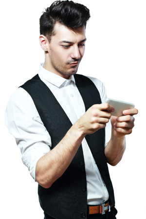 half length: half length portrait with young man playing on smartphone Stock Photo