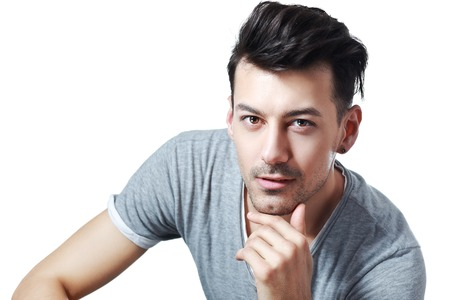 upper half: half length portrait with young handsome man with mysterious look Stock Photo