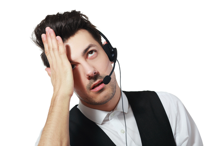 miscommunication: Tired call center operator isolated over white have a headache