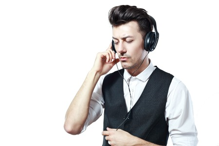 half length: half length portrait with adult man listening to the music in headphones on the white background Stock Photo