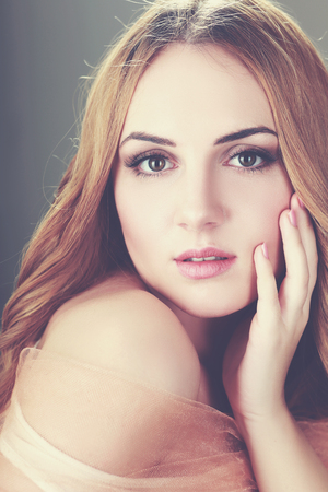 eyes hazel: magnificent portrait of a beautiful young woman with perfect skin, retro toning Stock Photo
