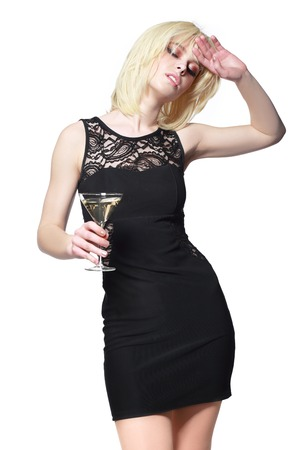 woman profile: young fashion woman with glass of martini, profile, studio shot