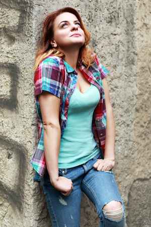 red haired woman: Beautiful red haired woman wearing jeans and shirt