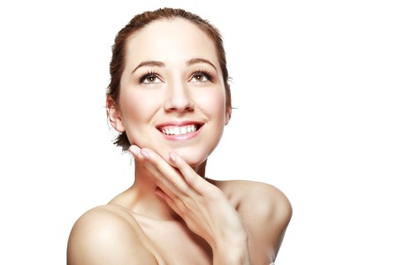 half length: half length portrait of european beautiful young woman smiling with hand on her chin isolated on white background