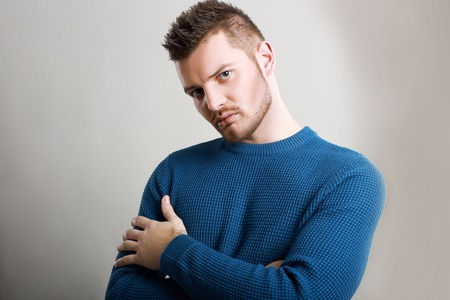 Portrait of Charming Bearded Man wearing blue sweater