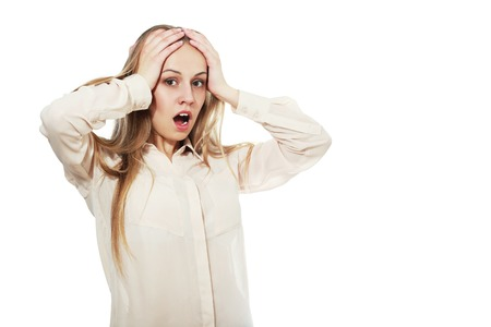 Hysterical woman expression with her hands on the head on a white isolated background Stock Photo