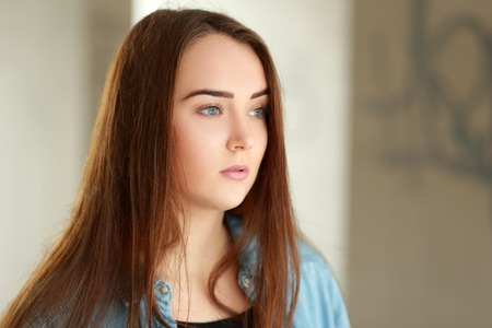 insulted: Close-up portrait of a sad young woman Stock Photo