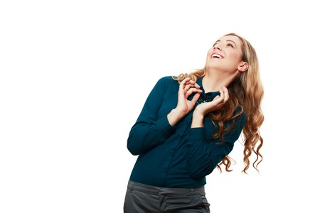 woman looking up and side smiling trying to hide from something falling above