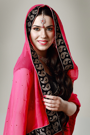 half length: half length portrait of happy indian woman on neutral background in photostudio Stock Photo