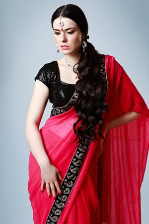 sari: half length portrait of beautiful indian woman posing in red sari Stock Photo