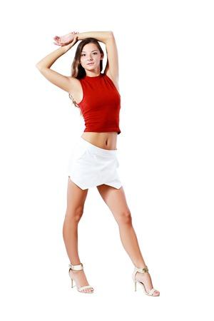 falda corta: Adolescente que presenta en falda corta Foto de archivo