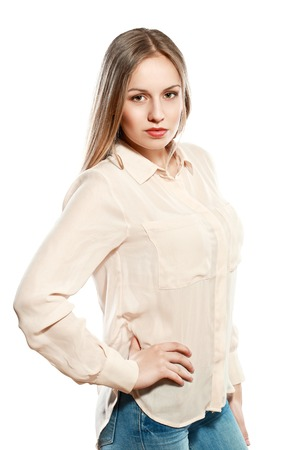 half lenght portrait of  young serious woman looking at camera isolated on white background in photostudio