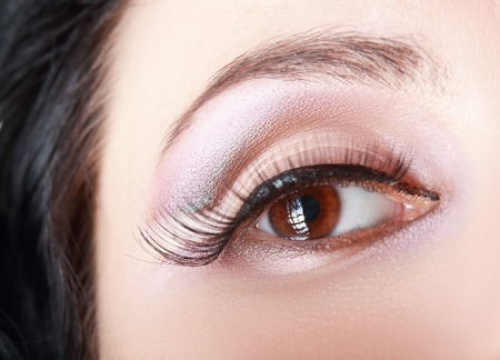 natural make up: macro shoot of womans eye with natural make up and black arrow Stock Photo