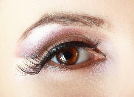 big ball: macro shoot of womans eye with natural make up and black arrow Stock Photo