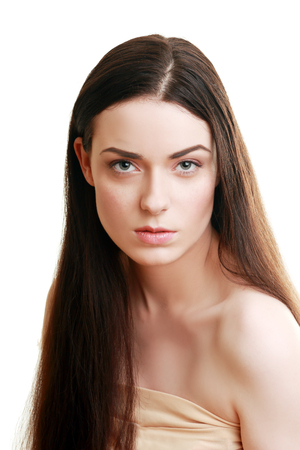 beautiful woman with brunnet hair looking at camera Stock Photo
