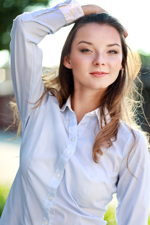 half length: half length portrait of beautiful young confident woman posing on nature Stock Photo