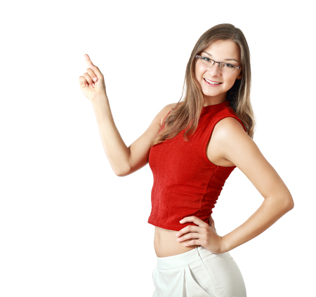 half length: half length portrait of cheerful young woman pointing isolated on white background in photo studio