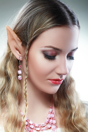 Stylish portrait of a beautiful young girl elf princess magical