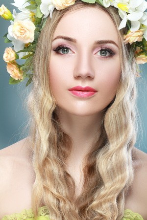 beautiful woman with flower wreath on her head Stock Photo
