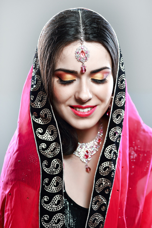 half length portrait: half length portrait of beautiful indian woman with bright makeup and  jewelry Stock Photo
