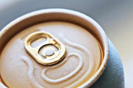 macro shot of frosted ised beer or fresh drink can top, covered with ice overfrosted, shallow depth