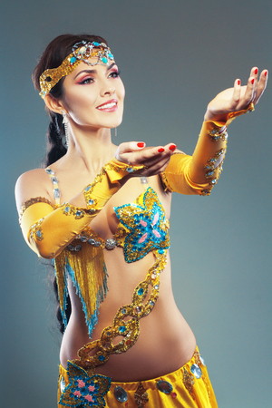 A portrait of a beautiful excotic belly dancer woman Stock Photo