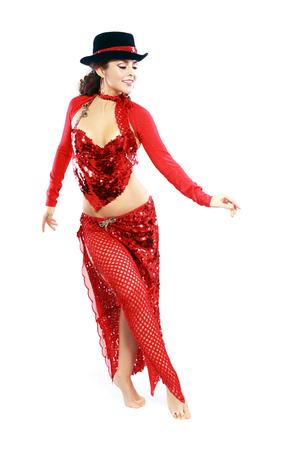 woman in red oriental tango costume in black hat Stock Photo