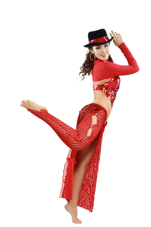 female christmas: woman in red oriental tango costume in black hat Stock Photo