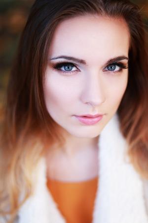 Young slim woman autumn portrait. Yellow orange colors. Stock Photo