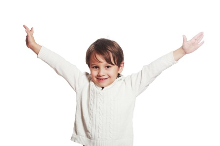 Happy five year old European boy posing over white studio background. Child with big smile. Stock Photo