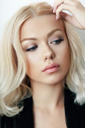 half length portrait: half length portrait of young beautiful woman posing in photostudio Stock Photo