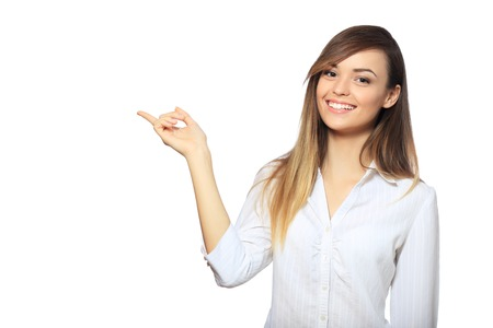 specifies: Young pretty office woman in white shirt specifies with finger to up isolated on white