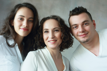 daughter in law: family headshot beautiful woman with grown up daughter and son