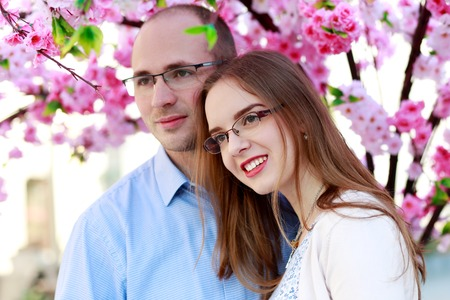 happy couple under blossom spring tree