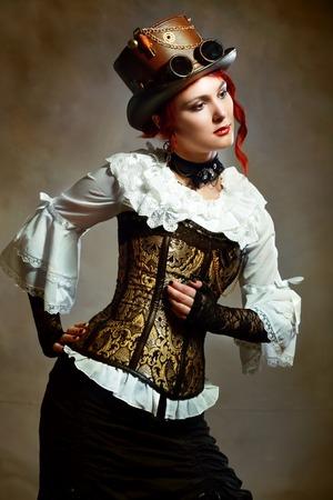 steampunk goggles: Portrait Beautiful Victorian Style Girl Wearing Steampunk Hat
