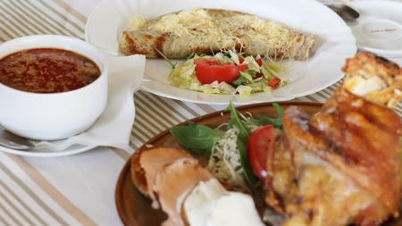 delicious dinnere, kapusnica, pork knee, zemiakove placky traditional slovakian food