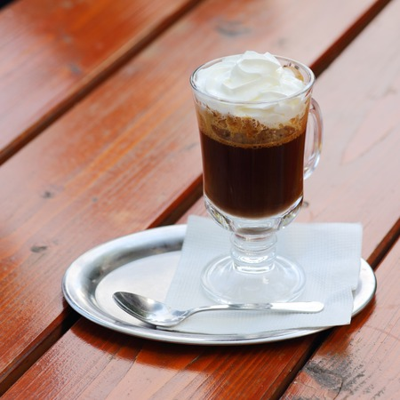 austrian coffee with cream on red cafe table